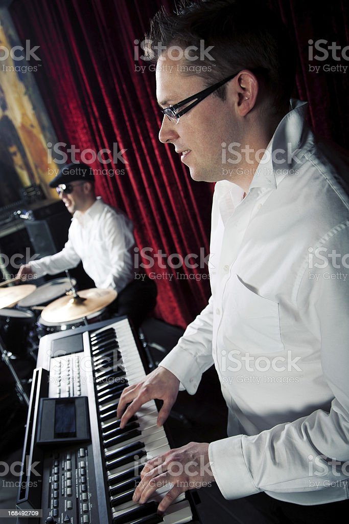 stylish drummer and pianist in night club royalty-free stock photo