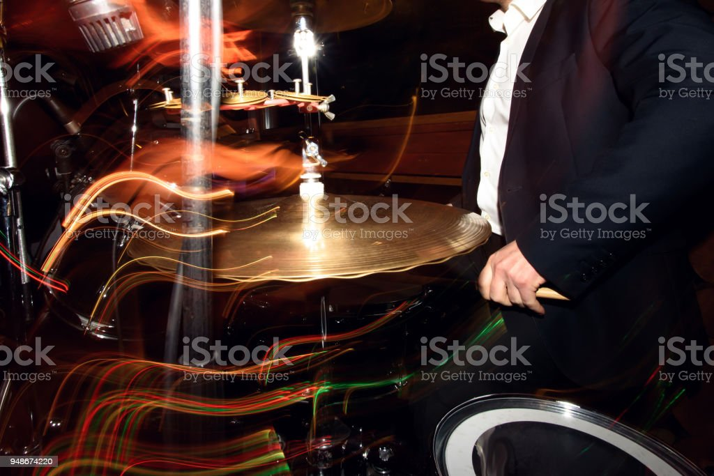 Stylish Drummer Playing On A Drums With A Band On Wedding Reception