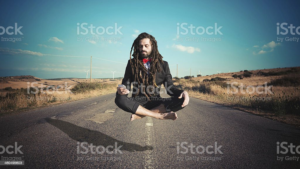 Stylish elegant dreadlocks businessman levitating stock photo