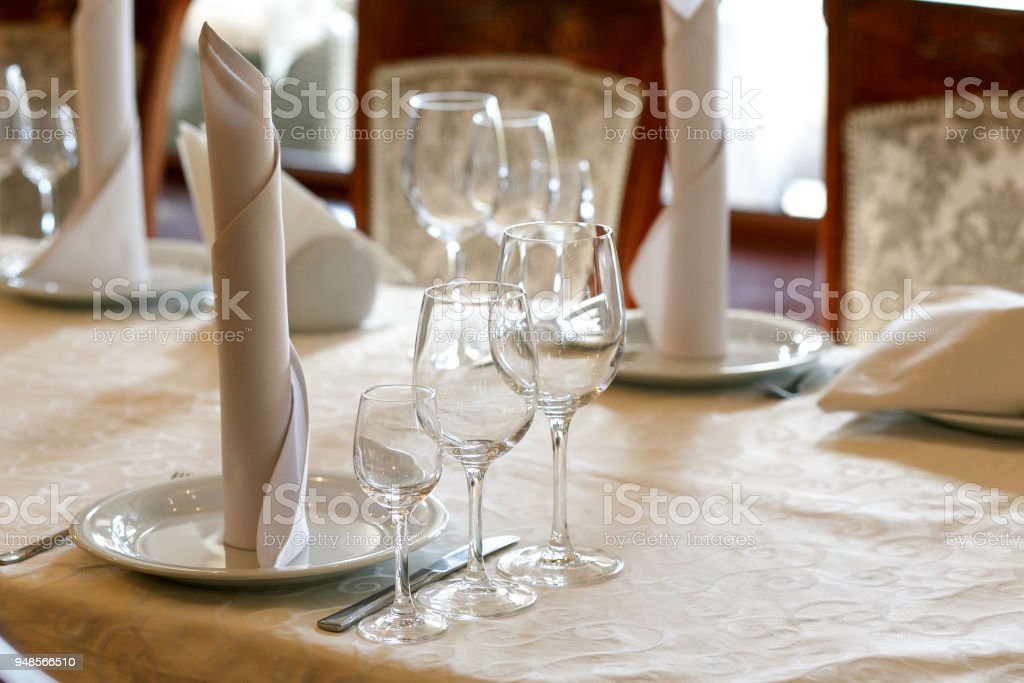 Stylish Empty Glasses And Plates At Setting At Elegant Table For