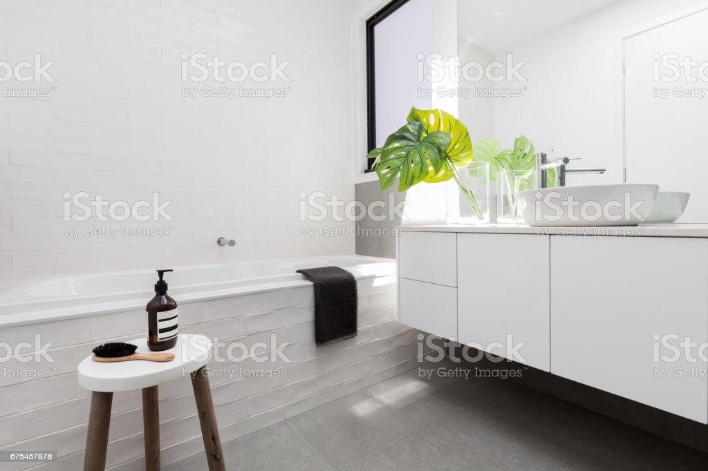 Stylish family bathroom in a white scandinavian theme stock photo