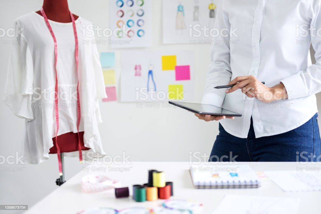 Stylish Fashion Designer Working With Measure Red Dummy As Sketches In Digital Tablet Of New Collection In Art Profession And Job Occupation Creative Design And Artistic Concept Stock Photo Download Image