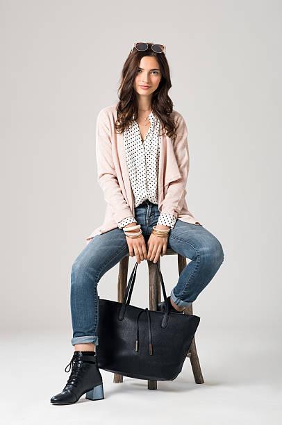 stylish fashion woman - handtasche jeans stock-fotos und bilder