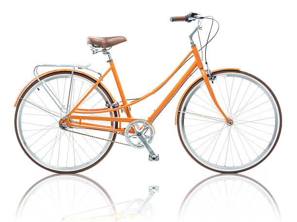 stylish female orange bicycle isolated on white - vélo photos et images de collection
