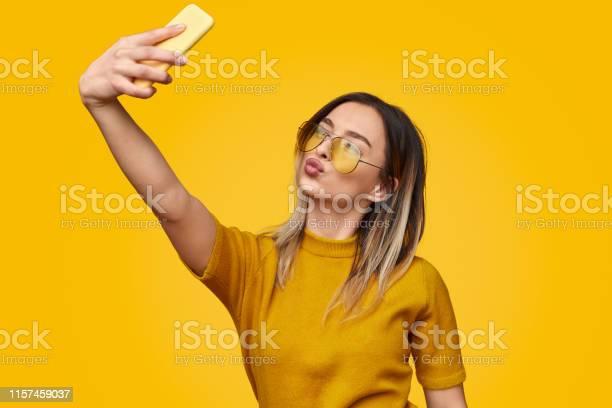 Stylish female pouting lips and taking selfie picture id1157459037?b=1&k=6&m=1157459037&s=612x612&h=y8xvpjvekpzc7plvfmdj1b 5l7bivhm6qb0unwk6bwu=