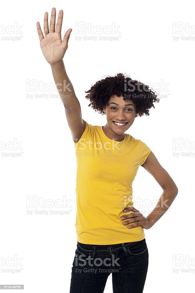 Stylish female waving her hand at you stock photo