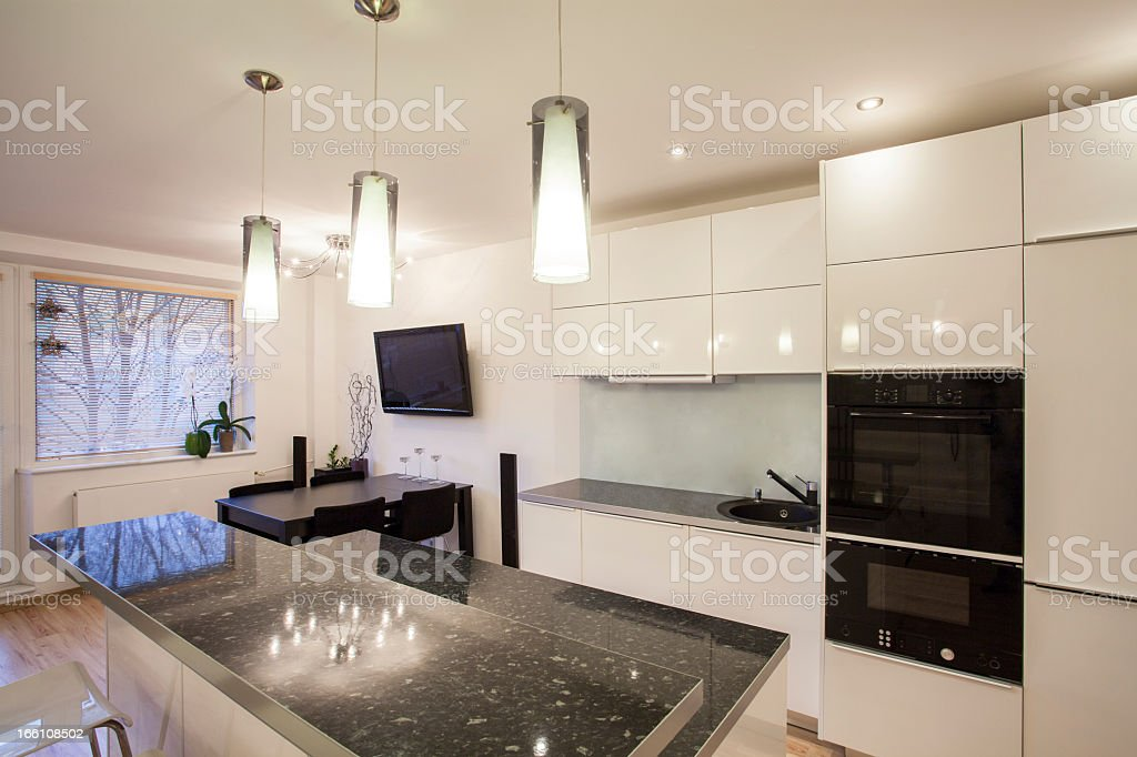 Stylish flat - Kitchen and dining room royalty-free stock photo