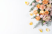 istock Stylish floral border of roses, hydrangeas, carnations and eucalyptus leaves. 1209362991
