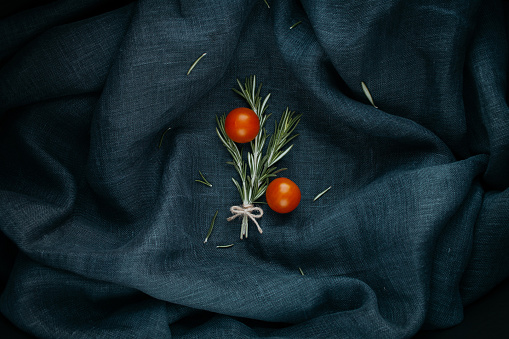 Stylish food. The rosemary and cherry tomatoes composition.