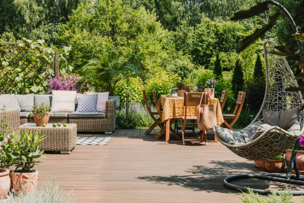 Stylish garden decoration with fancy egg chair and garden furniture stock photo