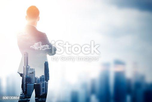 istock Stylish gentleman in trendy suit. Double exposure skyscraper on the 506130854