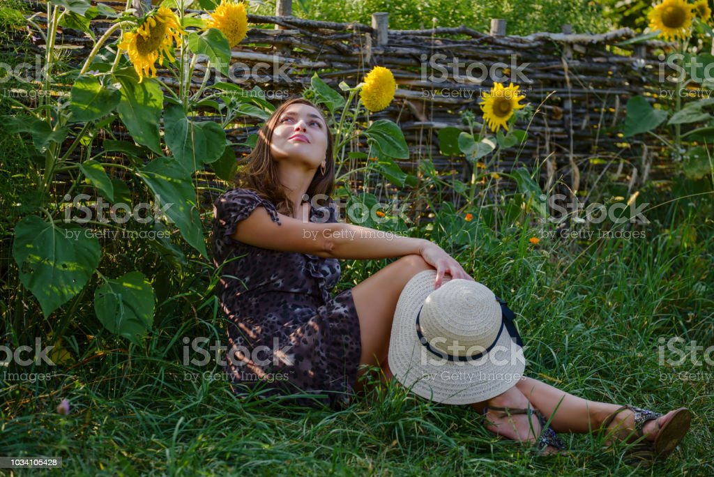 Stylish girl and picturesque summer garden stock photo