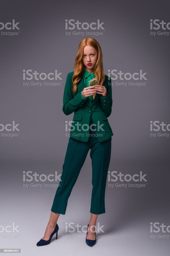 stylish girl in green suit stock photo