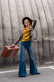 istock stylish girl in hat with suitcase 860106214