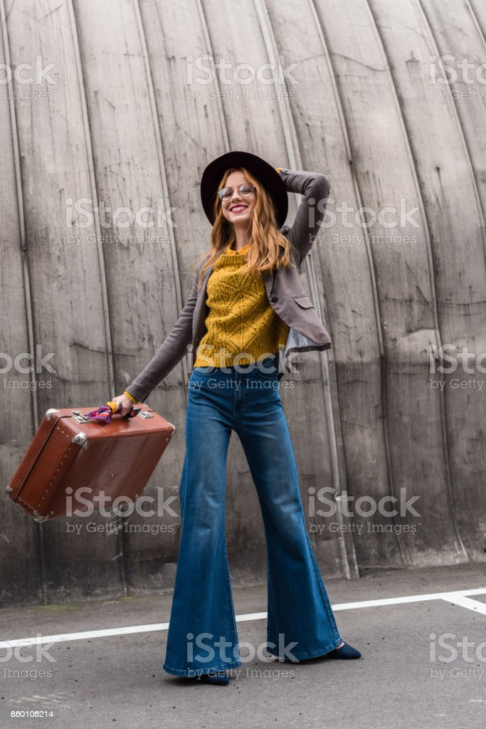 stylish girl in hat with suitcase stock photo