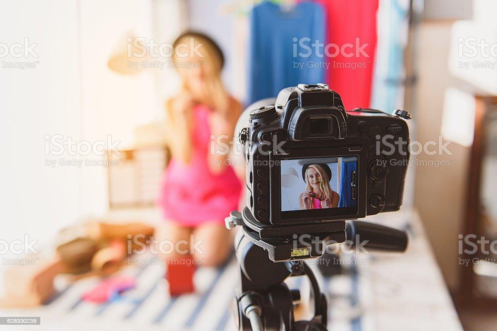 Stylish girl recording video for blog stock photo