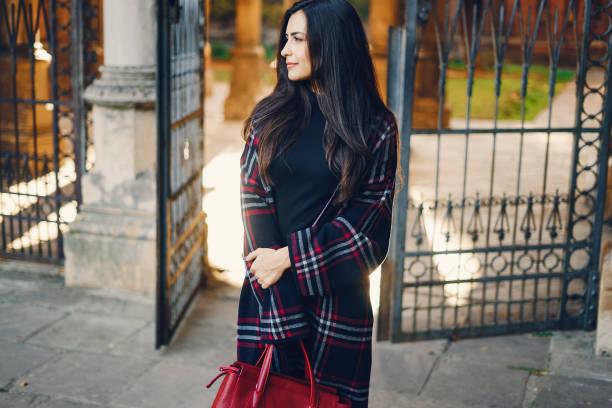 stylish girl walking through the city stock photo