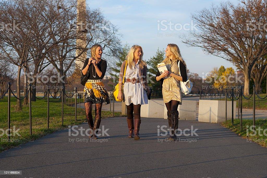 Stylish girls walking and talking royalty-free stock photo