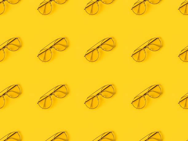 stylish Glasses isolated on yellow stock photo