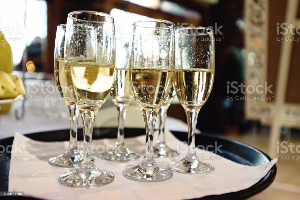 Stylish Glasses With Champagne On Tray Alcohol Bar At Luxury Wedding