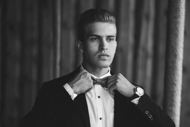stylish handsome groom wearing bow-tie. luxury fashion wedding - hochzeitsanzug herren stock-fotos und bilder
