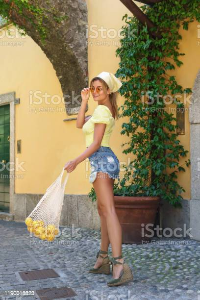 Stylish happy woman carrying lemons in the net bag picture id1190018823?b=1&k=6&m=1190018823&s=612x612&h=tm39xbylo67h2vc2xosl1ahyn2ygihqnzagch6fwvu0=