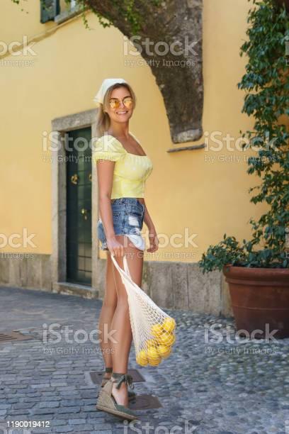Stylish happy woman carrying lemons in the net bag picture id1190019412?b=1&k=6&m=1190019412&s=612x612&h=y34frxapluyokjmkys2v86jaseuzwb9rq69i0cvfihc=