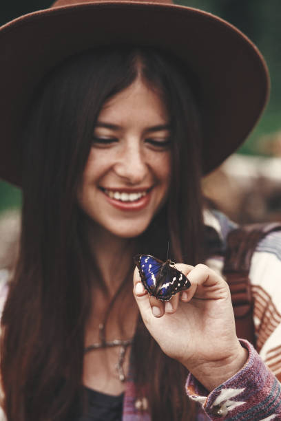 Stylish hipster girl in hat holding purple emperor butterfly on hand picture id1089240738?b=1&k=6&m=1089240738&s=612x612&w=0&h=bll5p5fo4b8ccoubryqyafy1jhvgl d 3c3icpwuimc=