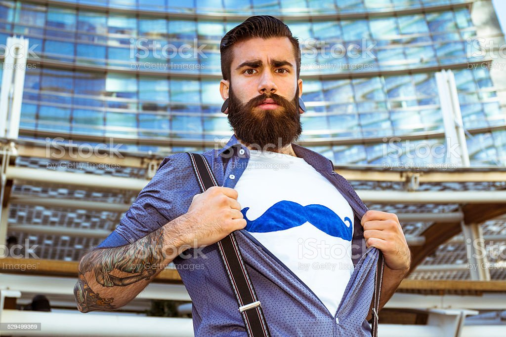 Stylish Hipster showing mustaches on t-shirt stock photo