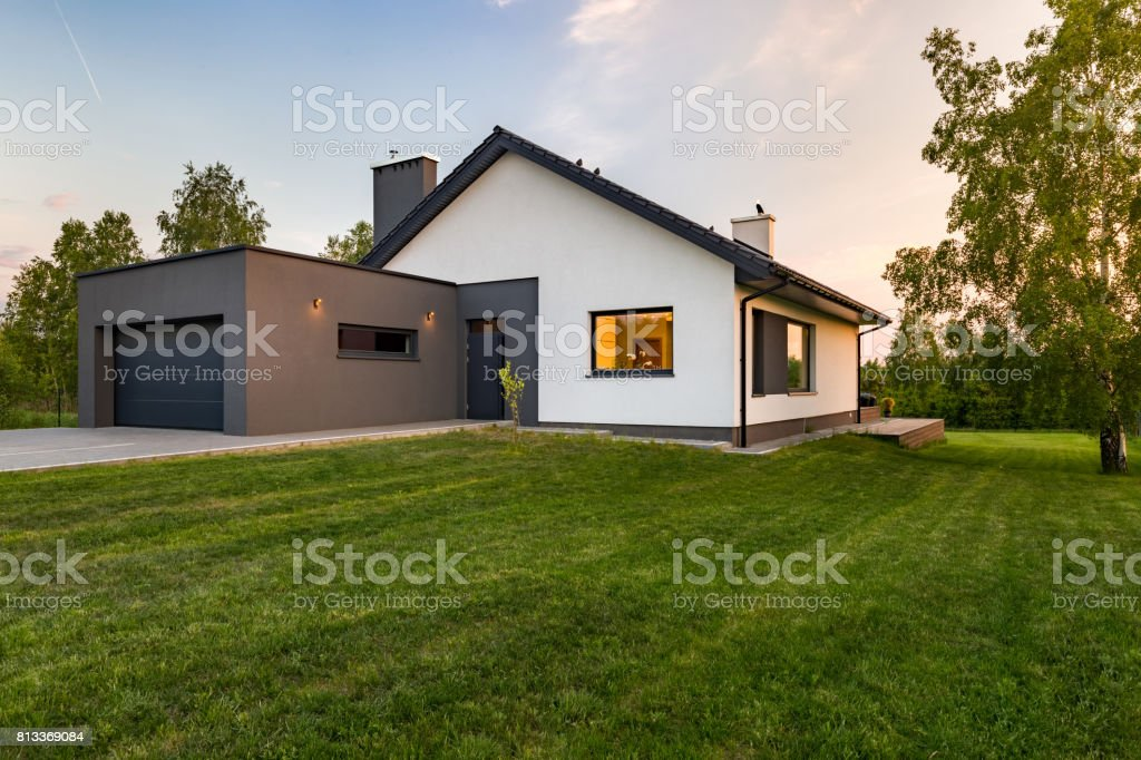 Stylish house with large lawn stock photo