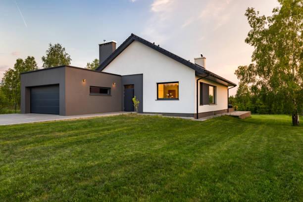 stylish house with large lawn - facciata foto e immagini stock