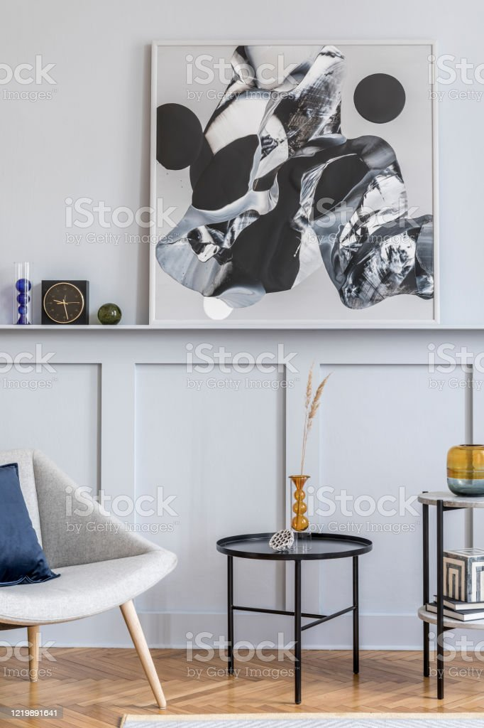 Stylish Interior Of Living Room With Design Grey Armchair Pillows Coffee Table Paintings Plant Decoration Black Clock And Elegant Personal Accessories In Modern Home Decor Stock Photo Download Image Now Istock