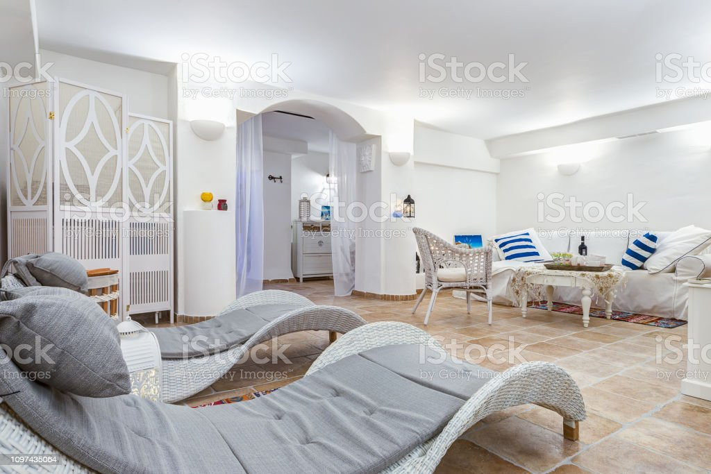 Awe Inspiring Stylish Interior Of Spa Center With Gray Sunbeds And Cozy Squirreltailoven Fun Painted Chair Ideas Images Squirreltailovenorg