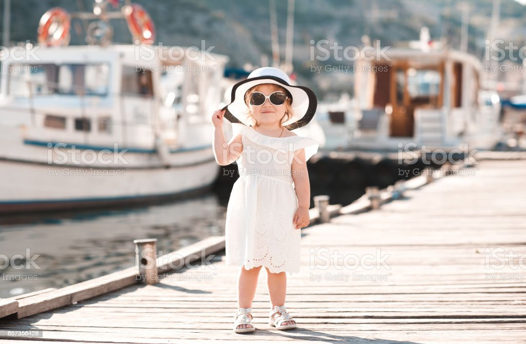 Stylish kid girl outdoors stock photo