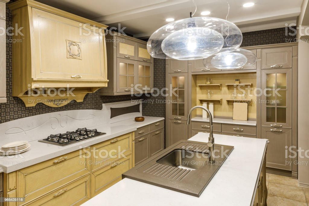 Stylish kitchen with chandelier over modern sink royalty-free stock photo