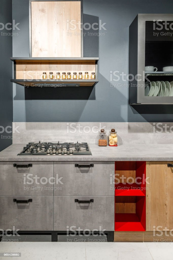 Stylish kitchen with elegant grey counter and stove royalty-free stock photo