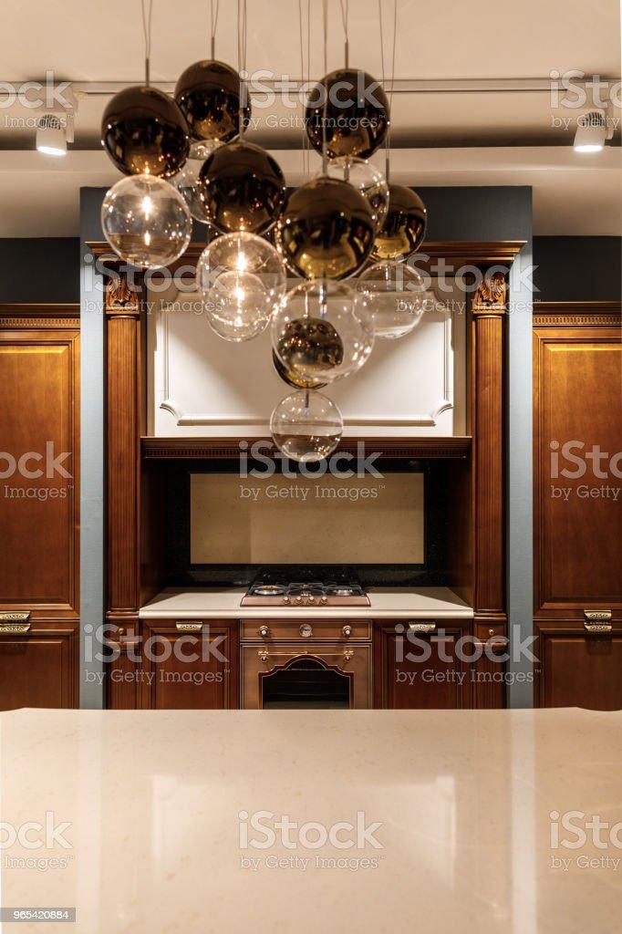 Stylish kitchen with elegant shiny table and chandelier zbiór zdjęć royalty-free