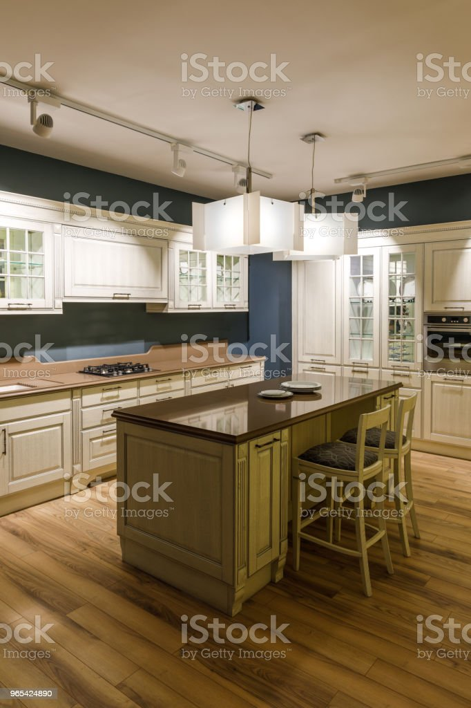 Stylish kitchen with elegant shiny table and chandelier royalty-free stock photo