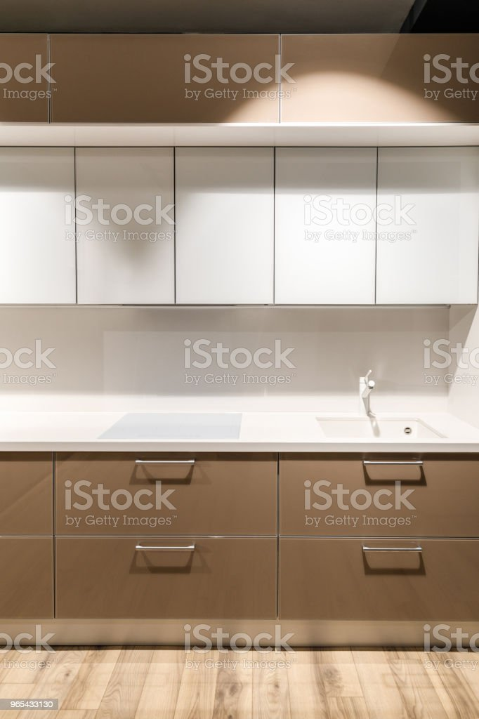 Stylish kitchen with elegant white and brown counter zbiór zdjęć royalty-free