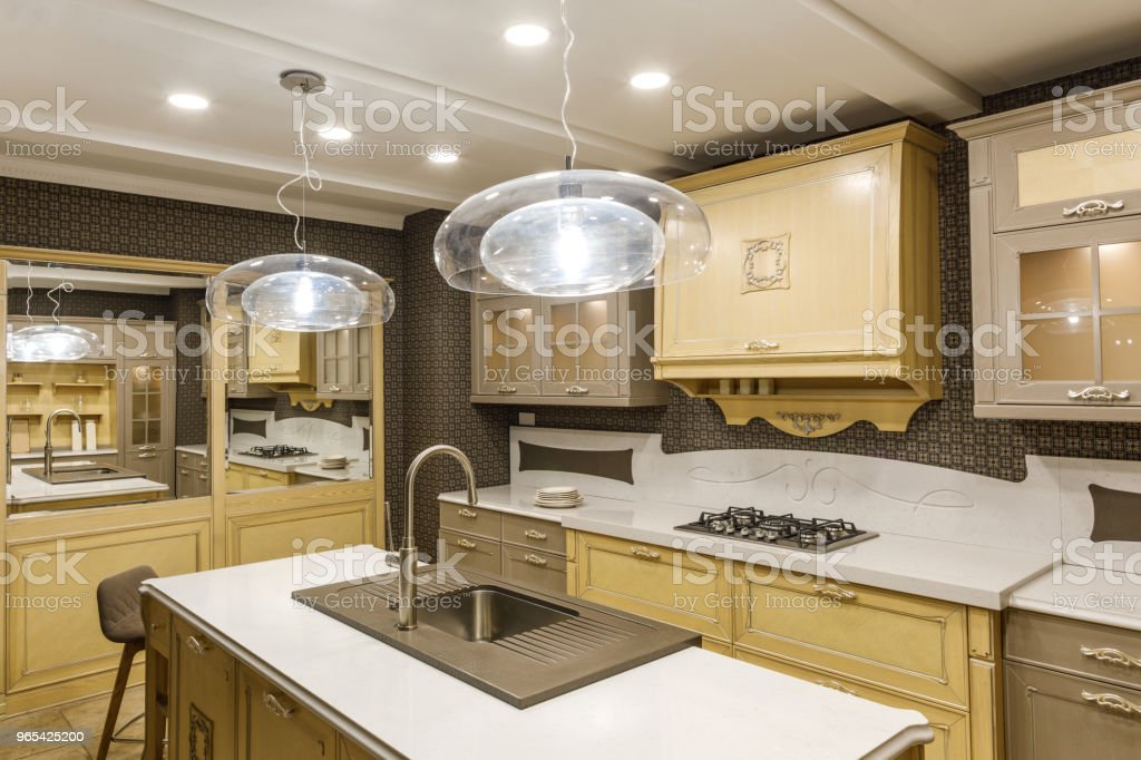 Stylish kitchen with elegant wooden counter and lamp zbiór zdjęć royalty-free