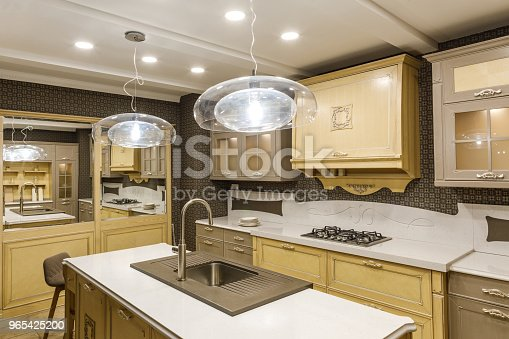 Stylish Kitchen With Elegant Wooden Counter And Lamp Stock Photo & More Pictures of Appliance