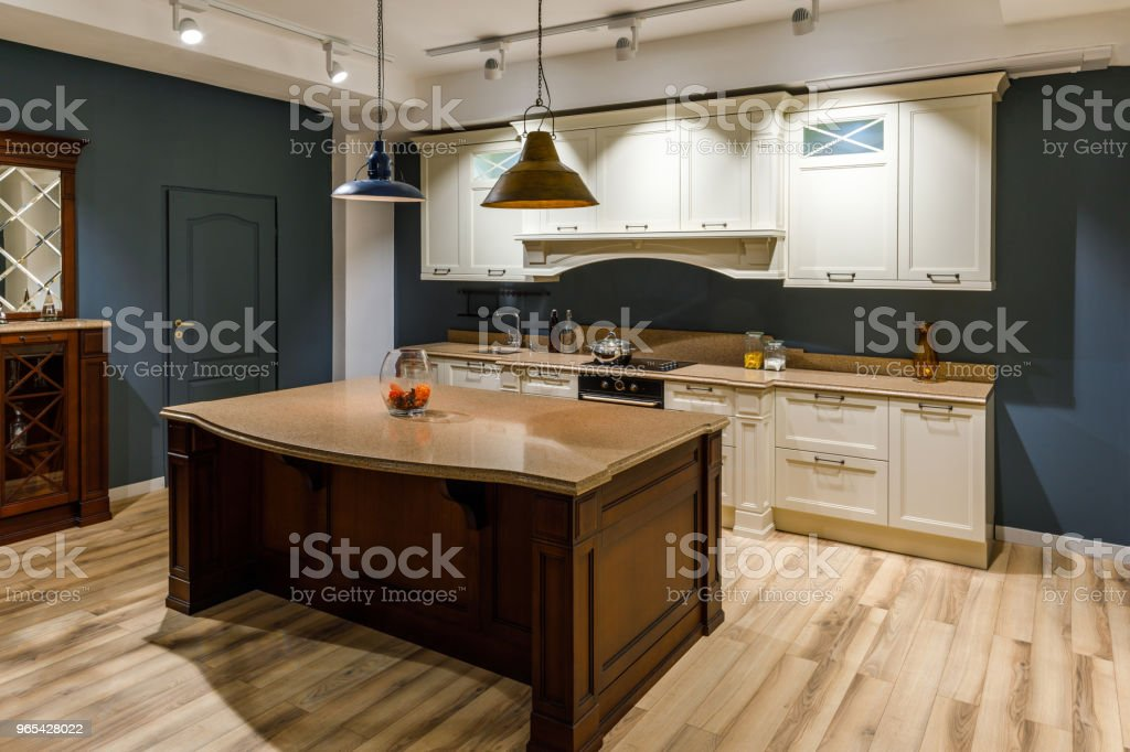 Stylish kitchen with elegant wooden counter and white cabinets zbiór zdjęć royalty-free
