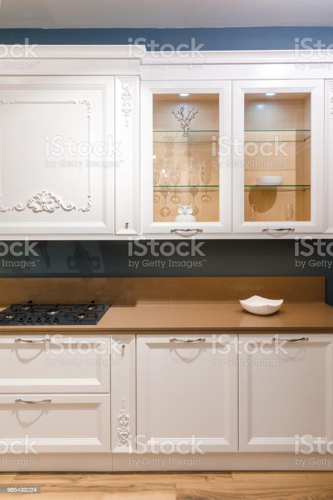 Stylish kitchen with elegant wooden counter royalty-free stock photo
