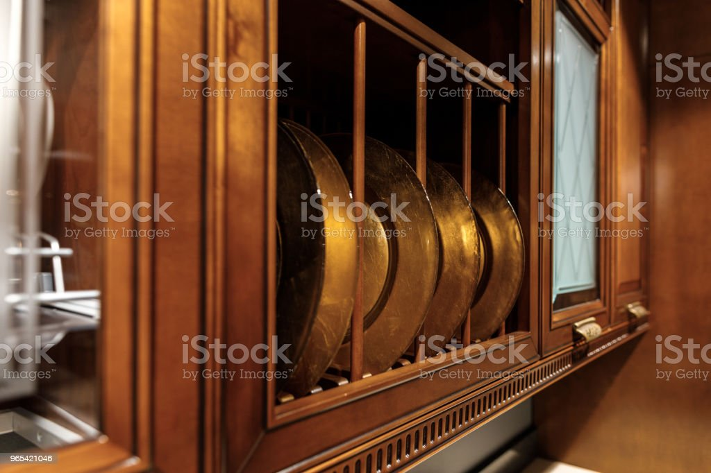 Stylish kitchen with metal plates in cupboard royalty-free stock photo