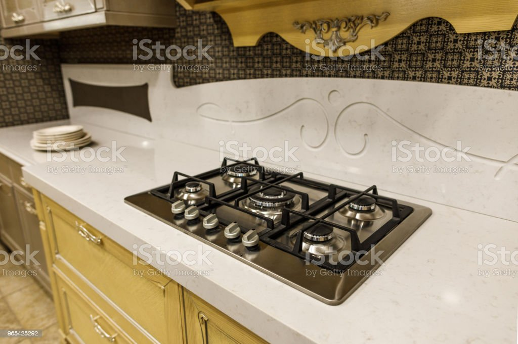 Stylish kitchen with stove on white counter royalty-free stock photo