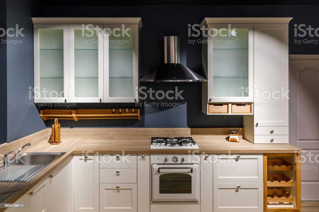 Stylish kitchen with vintage cabinets and stove zbiór zdjęć royalty-free