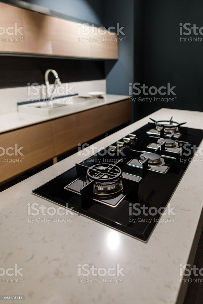 Stylish kitchen with with elegant shiny table and stove royalty-free stock photo