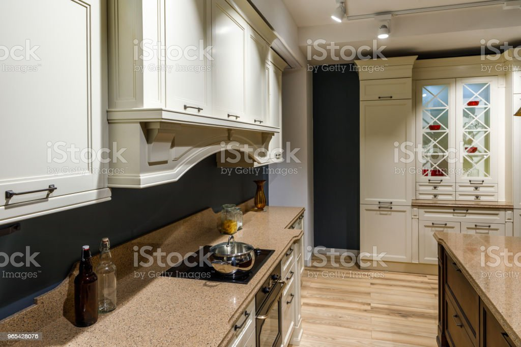 Stylish kitchen with with vintage style counter and stove royalty-free stock photo