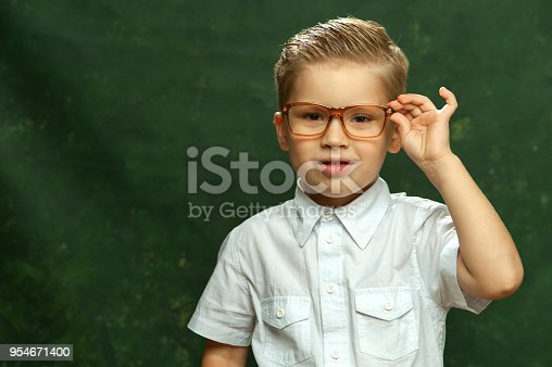 b2ec6026b7 ... Stylish Little Boy In White Shirt And Glasses Stock Photo   More  Pictures of Boys