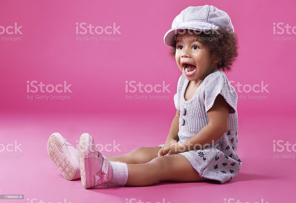 Stylish little girl playing up stock photo